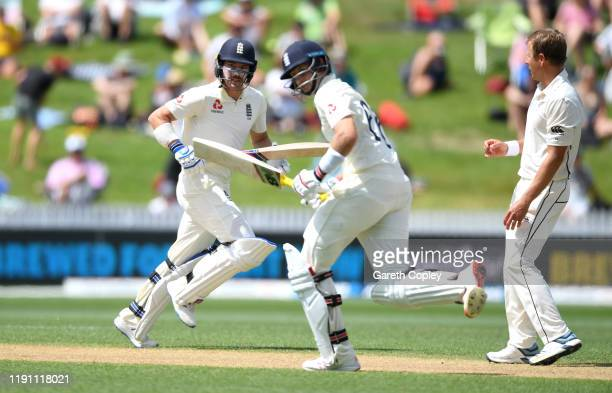 Rory Burns and Joe Root of England scores runs from the bowling of Neil Wagner of New Zealand during day 3 of the second Test match between New...