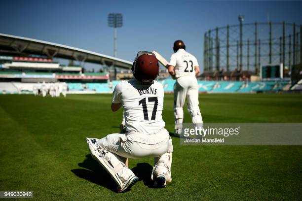 Rory Burns and Mark Stoneman of Surrey make their way to the middle to open the batting on day one of the Division One Specsavers County Championship...