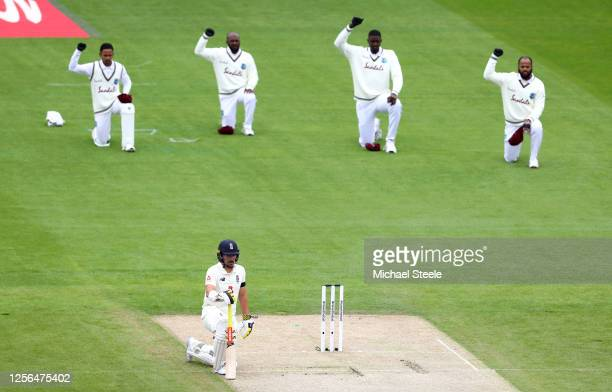 Rory Burns of England and members of the West Indies team take a knee in support of the Black Lives Matter movement during Day One in the 2nd Test...