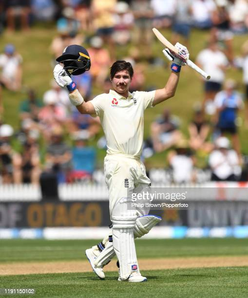 Rory Burns of England celebrates after reaching his century during day 3 of the second Test match between New Zealand and England at Seddon Park on...