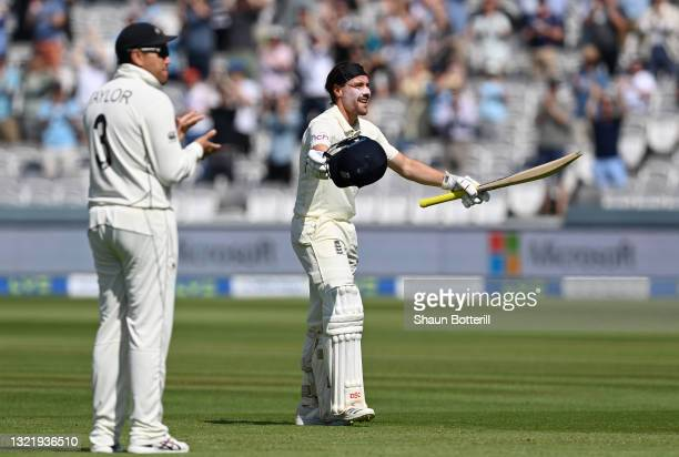 Rory Burns of England celebrates reaching his century as Ross Taylor of New Zealand applauds during Day 4 of the First LV= Insurance Test Match...