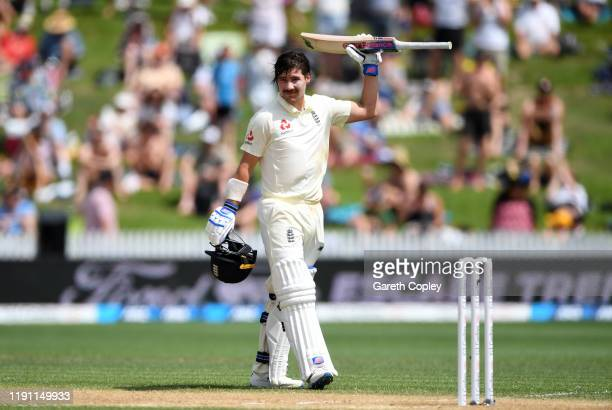 Rory Burns of England celebrates reaching his century during day 3 of the second Test match between New Zealand and England at Seddon Park on...