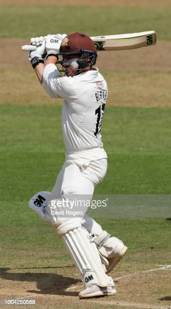 Rory Burns of Surrey cuts the ball to the boundary during the Specsavers County Championship division one match between Nottinghamshire and Surrey at...