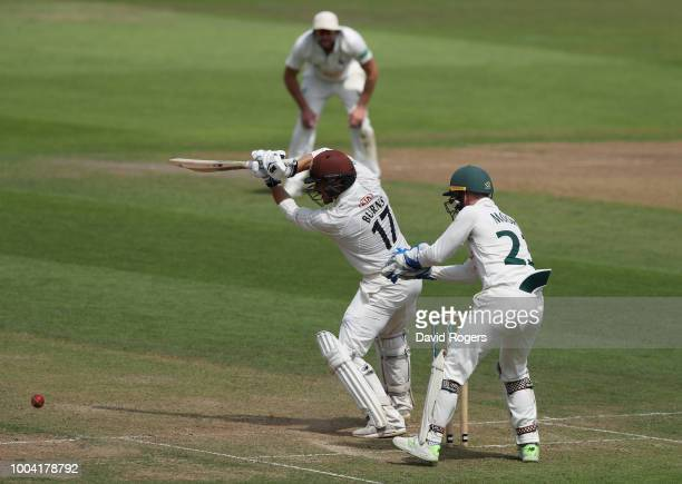 Rory Burns of Surrey drives for four runs during the Specsavers County Championship division one match between Nottinghamshire and Surrey at Trent...