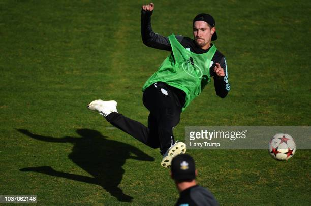 Rory Burns of Surrey plays football during a warm up during Day Four of the Specsavers County Championship Division One match between Somerset and...