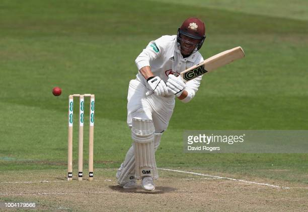 Rory Burns of Surrey pulls for four runs during the Specsavers County Championship division one match between Nottinghamshire and Surrey at Trent...