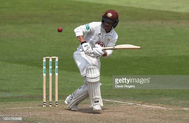Rikki Clarke of Surrey celebrares his century during the Specsavers County Championship division one match between Nottinghamshire and Surrey at...