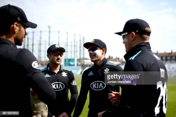 Rory Burns talks with Dean Elgar Jason Roy and Ben Foakes of Surrey prior to the start of the Royal London OneDay Cup match between Surrey and...