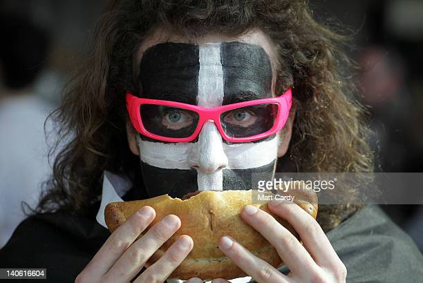 Rory Campbell from St Austell and sporting Cornish flags painted on his face try a Cornish pasty that has been baked as part of the World Cornish...