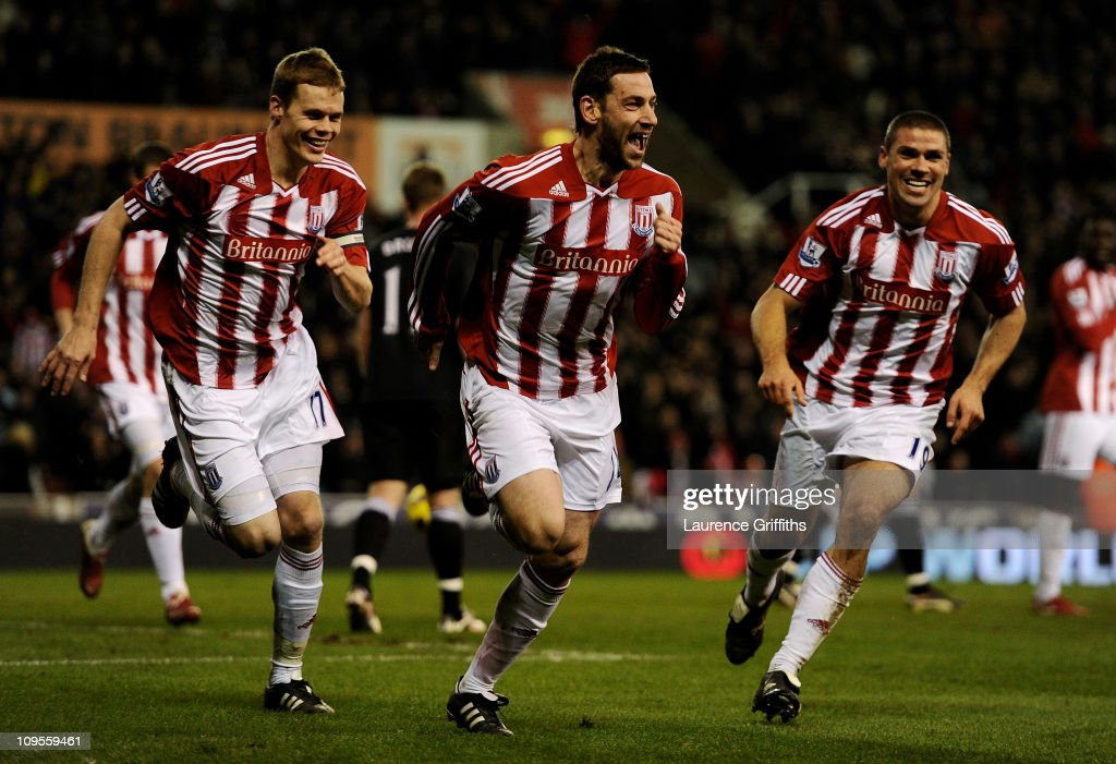 Rory Delap of Stoke City celebrates scoring the opening goal with team mates Ryan Shawcross (L) and Jonathan Walters (R) during the Barclays Premier League match between Stoke City and West Bromwich Albion at The Britannia Stadium on February 28, 2011 in Stoke on Trent, England.