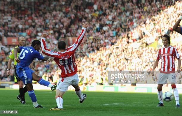 Rory Delap of Stoke City is unable to stop Florent Malouda of Chelsea scoring the winning goal during the Barclays Premier League match between Stoke...