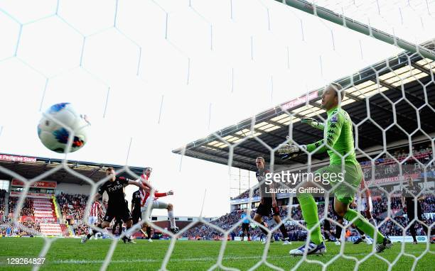 Rory Delap of Stoke City scores the second goal past Mark Schwarzer of Fulham during the Barclays Premier League match between Stoke City and Fulham...
