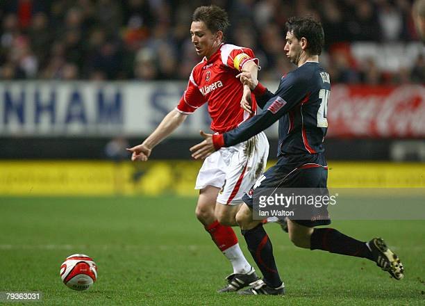 Rory Delap of Stoke City tries to tackle Matt Holland of Charlton Athletic during the Coca-Cola Championship match between Charlton Athletic and...
