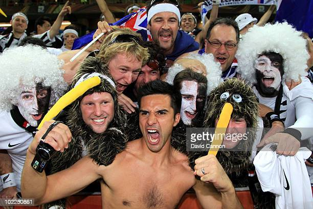 Rory Fallon of New Zealand celebrates with New Zealand fans after holding Italy to a draw in the 2010 FIFA World Cup South Africa Group F match...