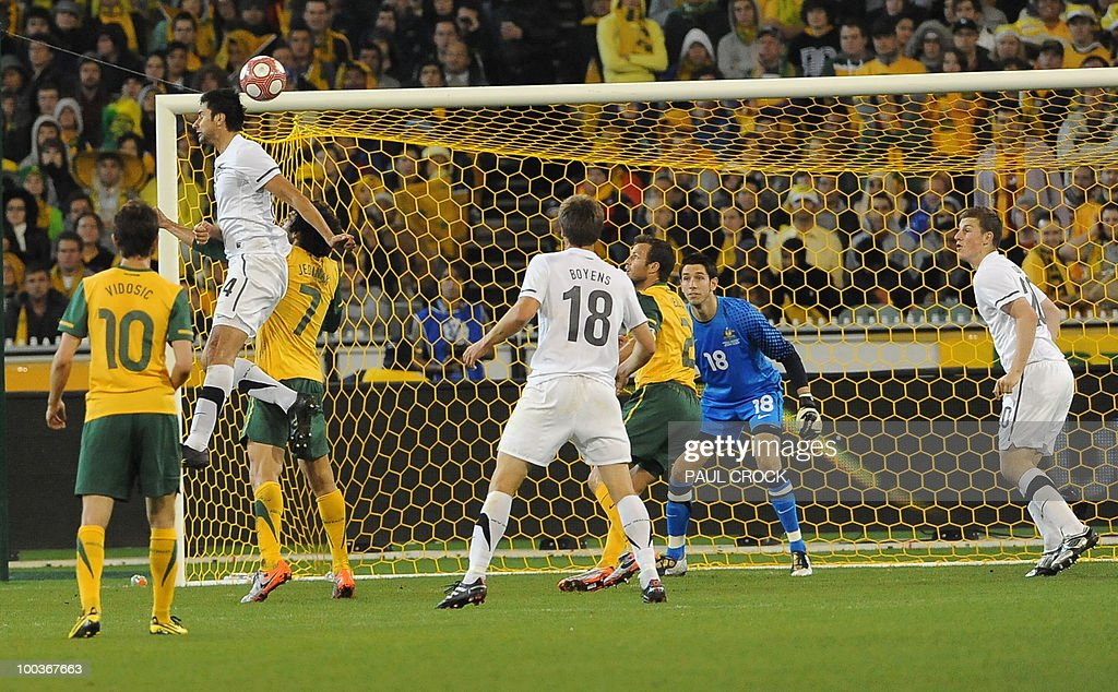 Rory Fallon of New Zealand (2L) rises up to head the ball towards the Australian goal during their friendly international football match in Melbourne on May 24, 2010. Australia won the match 2-1. RESTRICTED
