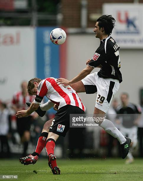 Rory Fallon of Swansea bundles over Michael Turner of Brentford during the Coca-Cola League One 2nd leg play-off semi final between Brentford and...