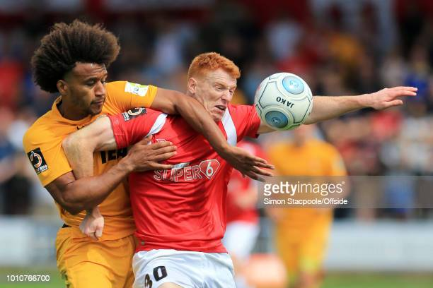 Rory Gaffney of Salford battles with Joe Widdowson of Orient during the Vanarama National League match between Salford City and Leyton Orient at Moor...