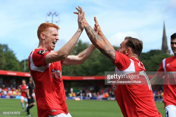 Rory Gaffney of Salford celebrates with teammate Danny Lloyd of Salford after scoring their 1st goal during the Vanarama National League match...