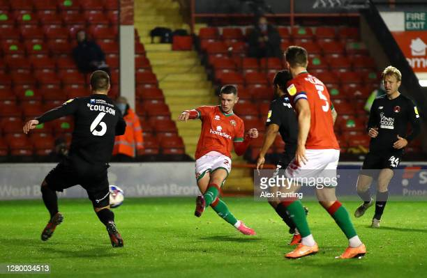 Rory Holden of Walsall scores his sides first goal during the Sky Bet League Two match between Walsall and Leyton Orient at Banks's Stadium on...