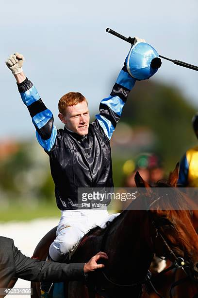 Rory Hutchings riding Soriano celebrates winning the Zabeel Classic during the Boxing Day Races at the Ellerslie Racecourse on December 26 2014 in...