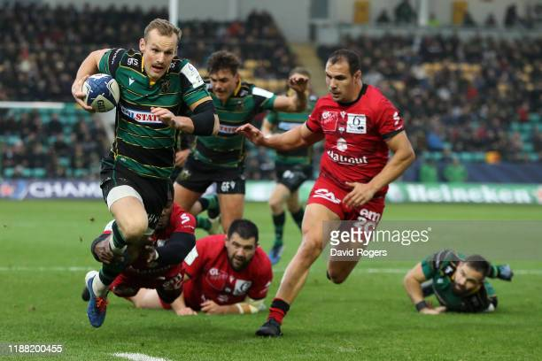 Rory Hutchinson of Northampton Saints breaks clear to score the first try during the Heineken Champions Cup Round 1 match between Northampton Saints...