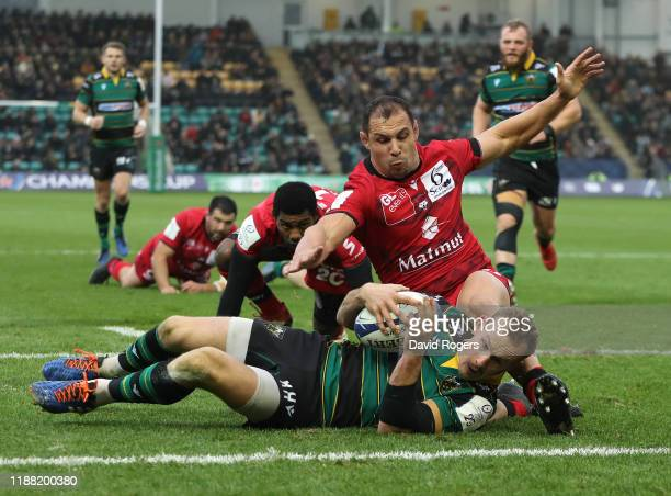 Rory Hutchinson of Northampton Saints dives over for the first try during the Heineken Champions Cup Round 1 match between Northampton Saints and...