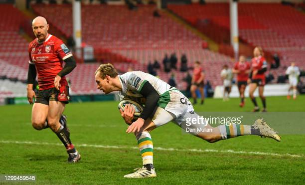 Rory Hutchinson of Northampton Saints runs in to scores his side's second try during the Gallagher Premiership Rugby match between Gloucester and...