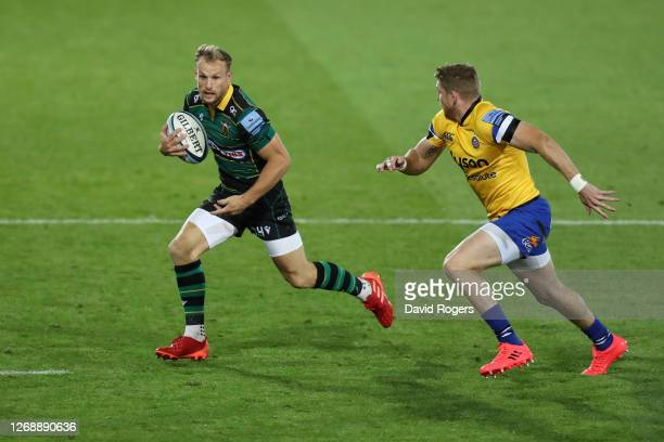 Rory Hutchinson of Northampton Saints runs with the ball as Ruaridh McConnochie of Bath chases during the Gallagher Premiership Rugby match between...