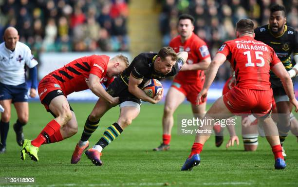 Rory Hutchinson of Northampton Saints tackled by Ali Crossdale of Saracens during the Premiership Rugby Cup Final match between Northampton Saints...