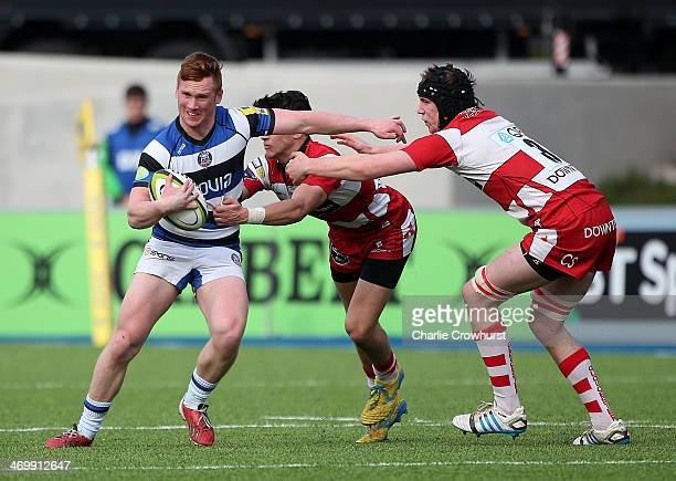 Rory Jennings of Bath holds of the Gloucester defence during the The U18 Academy Finals Day match between Bath and Gloucester at Allianz Park on...