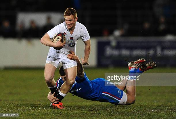 Rory Jennings of England is tackled by Dennis Bergamin of Italy during the U20s Six Nations match between England U20 and Italy U20 at Brickfields on...