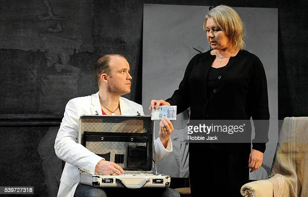 Rory Kinnear and Barbara Flynn perform in Thomas Middleton's play The Revenger's Tragedy at the National Theatre in London
