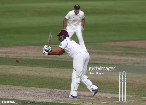 Rory Kleinveldt of Northamptonshire pulls for four runs during the Specsavers County Championship Division Two match between Northamptonshire and...