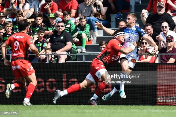 Rory Kockott of Castres and Raphael Lakafia of Toulon during the French Top 14 match between RC Toulon and Castres at Felix Mayol Stadium on April 28...