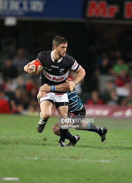 Rory Kockott of the Sharks is well held during the Absa Currie Cup match between the Sharks and GWK Griquas at Absa Stadium on August 27, 2010 in...