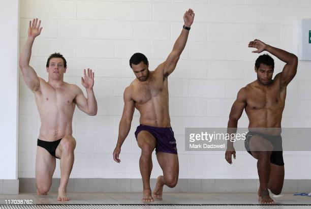 Rory Kostjasyn Dane Nielsen and Sisa Waqa exercise on the pool deck during a Melbourne Storm NRL recovery session at AAMI Park on June 20 2011 in...