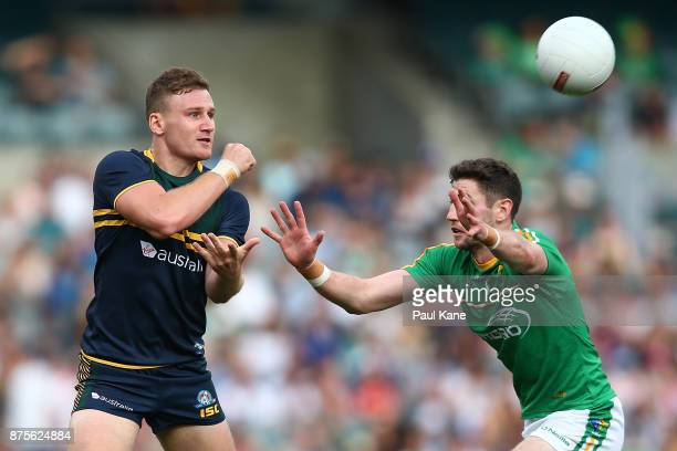Rory Laird of Australia handballs during game two of the International Rules Series between Australia and Ireland at Domain Stadium on November 18...