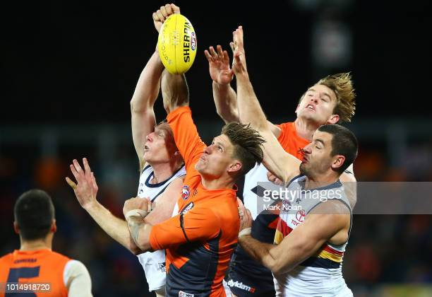Rory Lobb and Lachlan Keeffe of the Giants and Hugh Greenwood and Taylor Walker of the Crows contest a mark during the round 21 AFL match between the...