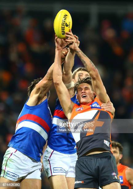 Rory Lobb of the Giants and Marcus Adams and Fletcher Roberts of the Bulldogs contest a mark during the round six AFL match between the Greater...