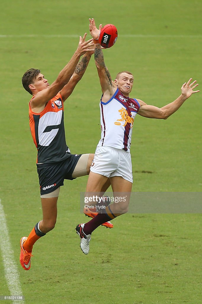 Rory Lobb of the Giants and Mitch Robinson of the Lions compete for the mark during the NAB Challenge AFL match between the Brisbane Lions and the Greater Western Sydney Giants at Metricon Stadium on March 13, 2016 in Gold Coast, Australia.