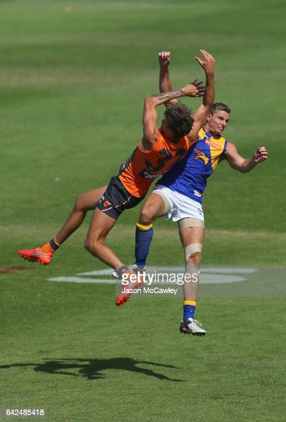 Rory Lobb of the Giants and Nathan Vardy of the Eagles compete for a mark during the 2017 JLT Community Series match between Greater Western Sydney...