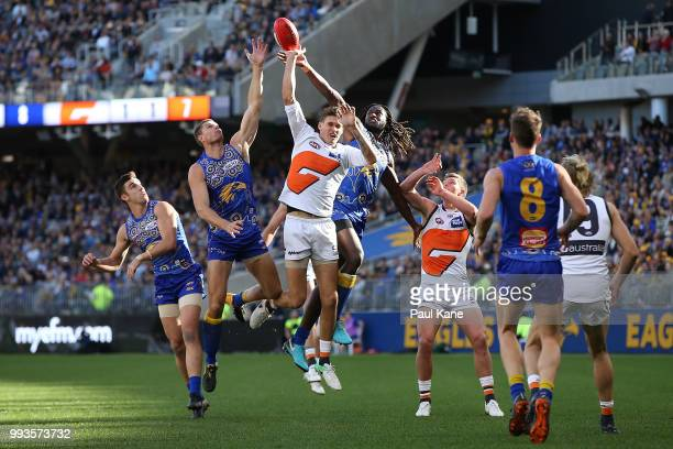 Rory Lobb of the Giants and Nic Naitanui of the Eagles contest the ruck during the round 16 AFL match between the West Coast Eagles and the Greater...