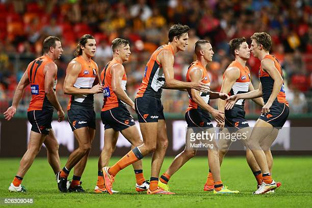 Rory Lobb of the Giants celebrates with team mates after kicking a goal during the round six AFL match between the Greater Western Sydney Giants and...
