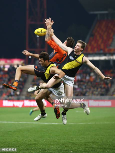 Rory Lobb of the Giants is challenged by Alex Rance and Dylan Grimes of the Tigers during the round 17 AFL match between the Greater Western Sydney...