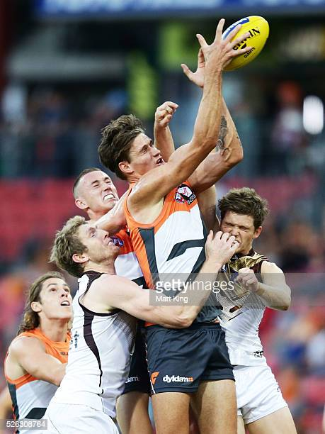 Rory Lobb of the Giants is challenged during the round six AFL match between the Greater Western Sydney Giants and the Hawthorn Hawks at Spotless...