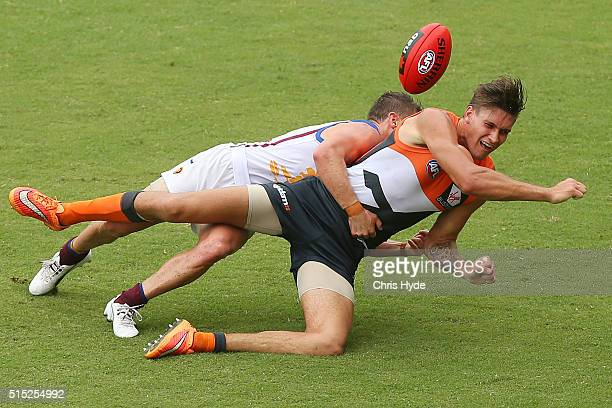Rory Lobb of the Giants is tackled by Dayne Zorko of the Lions during the NAB Challenge AFL match between the Brisbane Lions and the Greater Western...