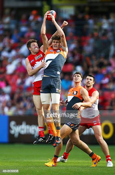 Rory Lobb of the Giants takes a mark under pressure from Jermemy Laidler of the Swans during the round 21 AFL match between the Greater Western...