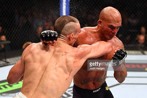 Rory MacDonald and Robbie Lawler exchange punches in their UFC welterweight title fight during the UFC 189 event inside MGM Grand Garden Arena on...