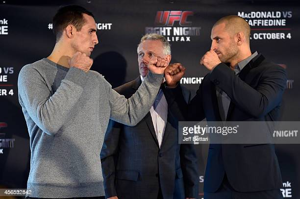Rory MacDonald and Tarec Saffiedine face off during the UFC Fight Night Ultimate Media Day on October 2, 2014 in Halifax, Nova Scotia, Canada.