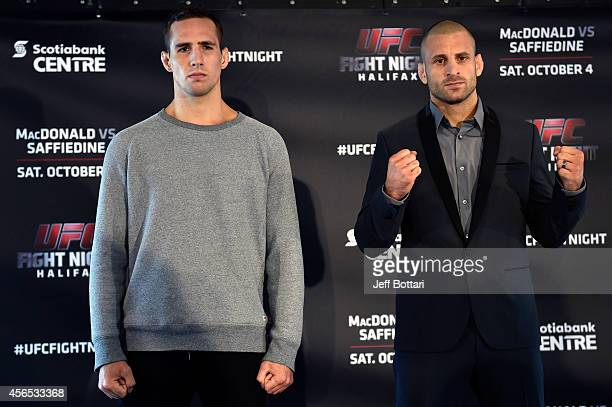 Rory MacDonald and Tarec Saffiedine pose for the media during the UFC Fight Night Ultimate Media Day on October 2, 2014 in Halifax, Nova Scotia,...
